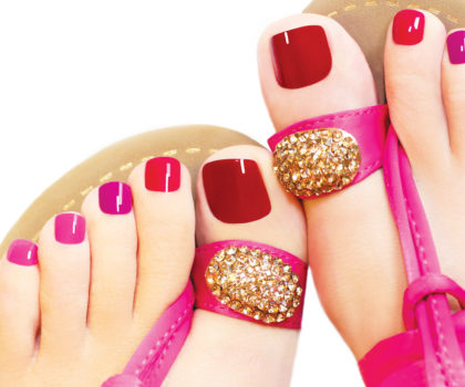 A soothing pedicure with colorful nail polish can be the perfect pick-me-up