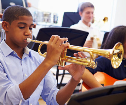 How learning to play a musical instrument can help your child in school